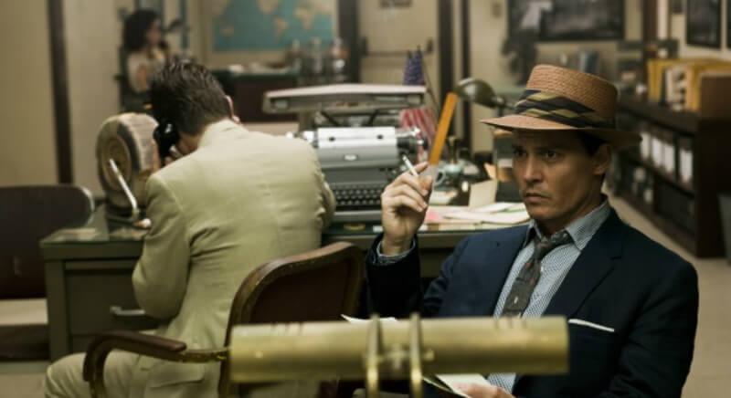 Мужчина в шляпе и с сигаретой